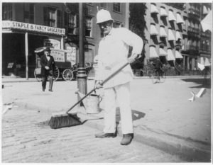 Person sweeping street   A Brief History on Street Sweepers   Wafer Brushes used by New York City Street Sweepers   Smith Equipment